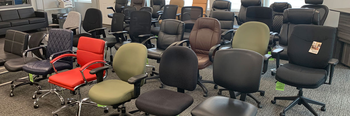 An assortment of rolling  office chairs